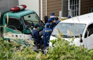 Japanese Policemen at the Tokyo flat where nine mutilated bodies were found