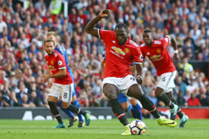 Lukaku: Manchester United's Belgian striker Romelu Lukaku takes his penalty which was saved by Leicester City's Danish goalkeeper Kasper Schmeichel during the English Premier League football match between Manchester United and Leicester City at Old Trafford in Manchester, north west England, on August 26, 2017. / AFP PHOTO
