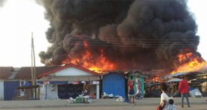 Fire razes shops in market