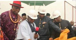 Nigeria's former President and Special Guest of Honour, Chief Olusegun Obasanjo (2nd L), supported by the Bayelsa State Governor, Hon. Seriake Dickson (2nd R), Chairman, State Traditional Rulers Council, HRM. King Alfred Diete Spiff, and the President, Azikel Group, Dr. Azibapu Eruani (R), unveils the plaque for the historic Refinery project by the Azikel Group, at Obunagha, Yenagoa LGA.