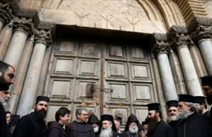 hurch leaders in front of the Church of the Holy Sepulcher in Jerusalem