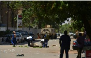 Burkina Faso's Ouagadougou residents watch as soldiers take position near the French embassy on Friday