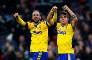 Juventus strikers Hugain and Dybala- ruin Tottenham Hotspur in London