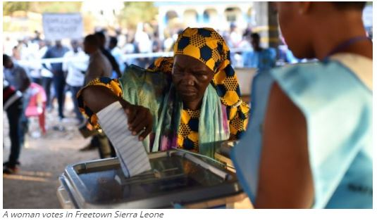 A woman votes in Freetown Sierra Leone