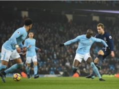 Tottenham Hotspur's Danish midfielder Christian Eriksen (R) shoots and scores during the English Premier League football match between Manchester City and Tottenham Hotspur at the Etihad Stadium in Manchester, north west England, on December 16, 2017. / AFP PHOTO