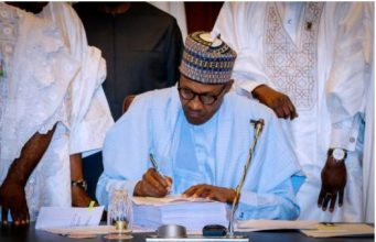 President Buhari: signing the mutilated budget