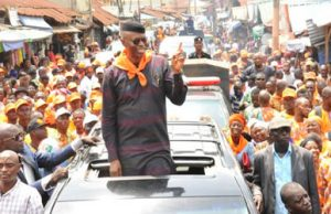 Dr. Olusegun Mimiko being cheered by crowd of supporters