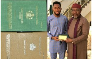 Miracle Ikechukwu presents his license to Gov. Rochas Okorocha of Imo state