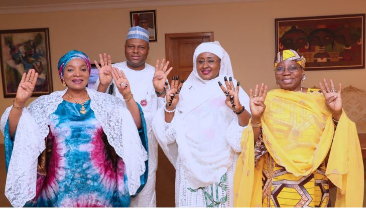 Aisha Buhari, joined by Dr Hajo Sani, Hadiza Dahiru Abba and Alh Usman Halilu Ahmed, strike 4+4 pose