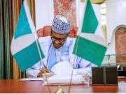 Buhari: signs the minimum wage bill into law