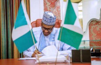 Buhari: signs the minimum wage bill into law