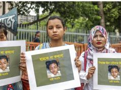 Bangladeshi women hold placards and photographs of schoolgirl Nusrat Jahan Rafi at a protest in Dhaka, following her murder by being set on fire after she had reported a sexual assault. SAZZAD HOSSAIN / AFP