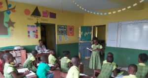 Primary 5 pupil, Treasure Adigun reading to her classmates during a literacy lesson